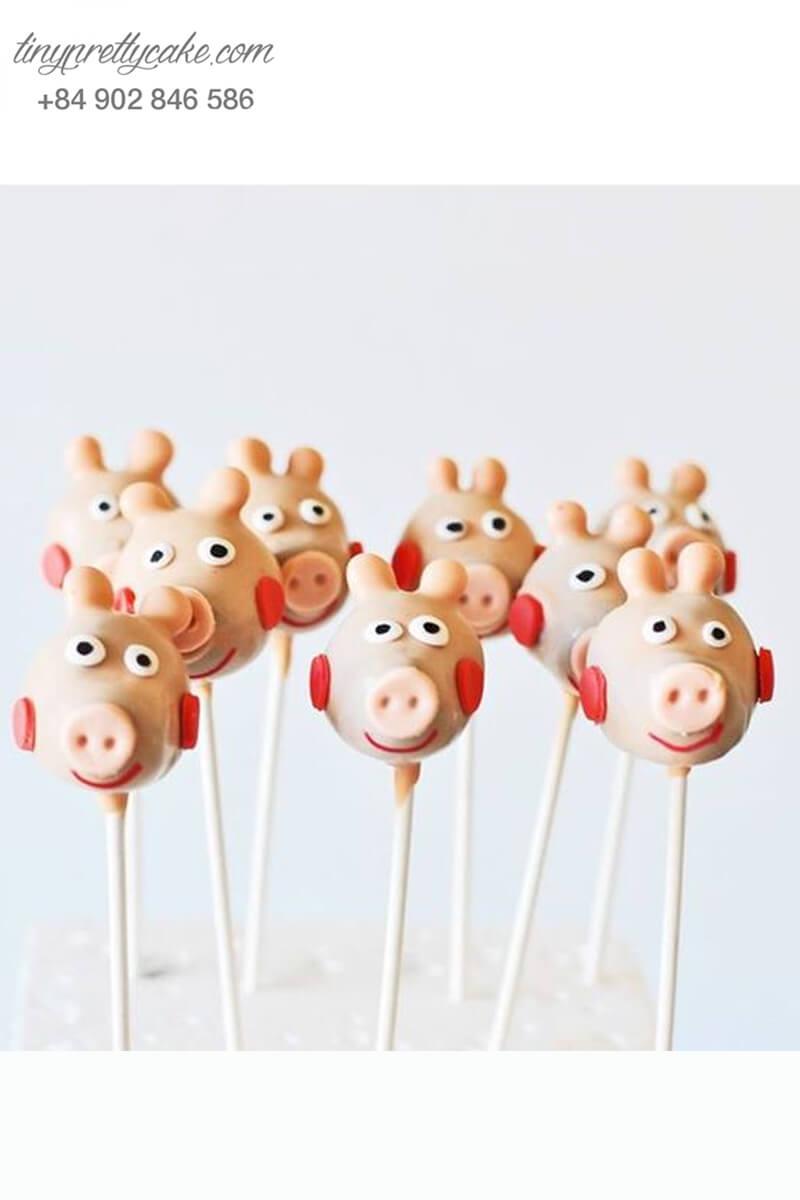 Bánh cakepop tạo hình chú heo má ửng hồng đáng yêu để trang trí tiệc sinh nhật, đầy tháng cho các bé