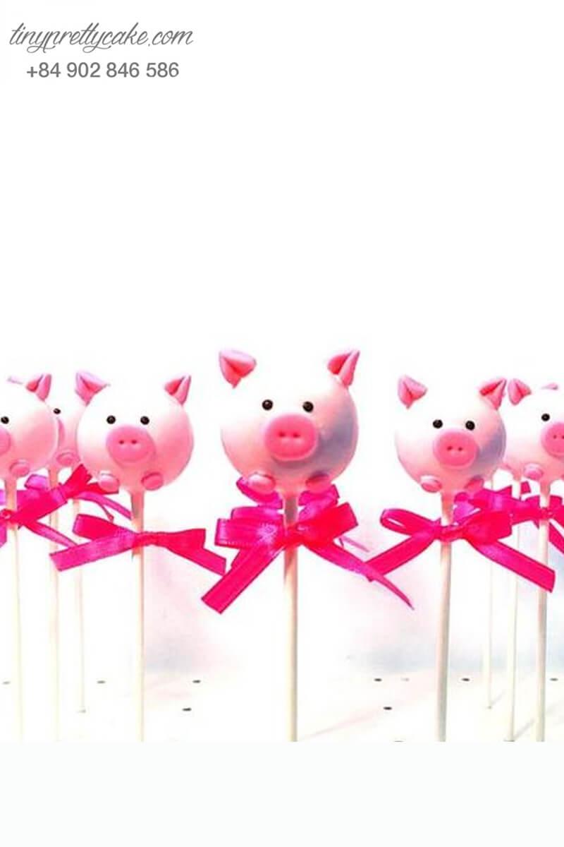 Bánh cakepop tạo hình chú chó Peppa hồng siêu yêu cùng chiếc nơ nhỏ xinh để trang trí tiệc sinh nhật, đầy tháng cho các bé