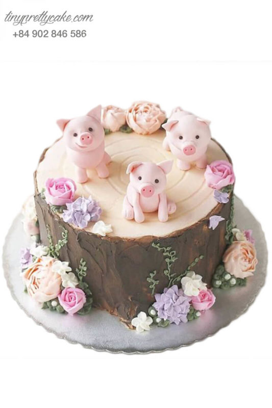 Bánh gato khúc cây cùng những chú heo dễ thương, mừng sinh nhật, đầy tháng cho các bé.